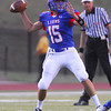 Moore quarterback Colin Webb (15) throws a pass during the Lions' game against US grant Thursday at Moore Stadium.<br /> Kyle Phillips/The Transcript
