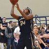 Southmoore's  Kyeria Hannah shoots the ball during the Sabercats' game against Edmond Memorial Saturday during the State Regional Basketball Tournament.<br /> Kyle Phillips/The Transcript