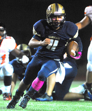 Southmoore quarterback Tre Edwards runs with the ball during the Sabercats' game against Norman High Friday night at Moore Stadium.<br /> Kyle Phillips/The Transcript