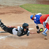 Moore High's (19) dives for home as she tries to avoid being tagged out Friday during the Lions' game against Broken Arrow during the 6A state softball tournament at the ASA Hall of Fame Stadium.<br /> Kyle Phillips/The Transcript