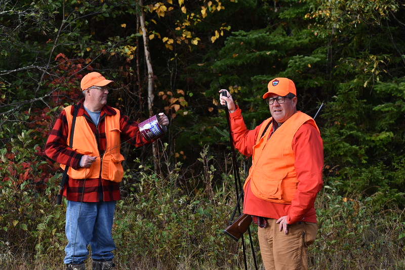 BDN Outdoors Editor John Holyoke (right) checks out the surroundings while sub-permittee Chris Lander of Orrington fires off a few calls using a coffee can during last week's moose hunt. (Pete Warner | BDN)