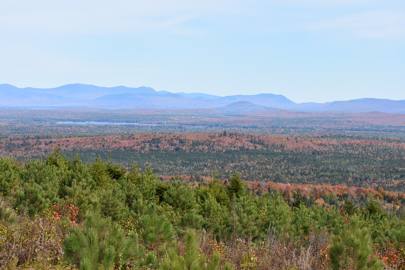 A view from high on a ridge shows some of the gorgeous views of the October foliage against a backdrop of a mountain range during last week's moose hunt in Somerset County. (Pete Warner | BDN)