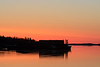 Looking down the Moose River before sunrise. Sun will rise over barges in the river.