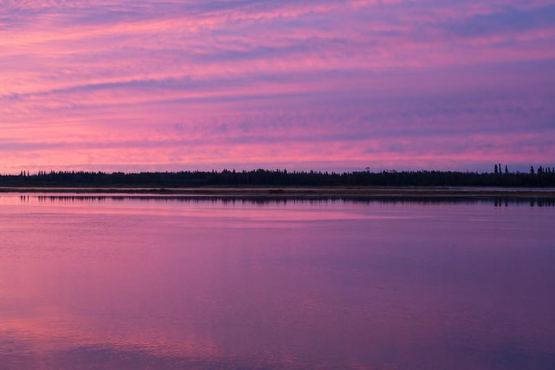 Purple sky and water across the Moose River from Moosonee before sunrise.