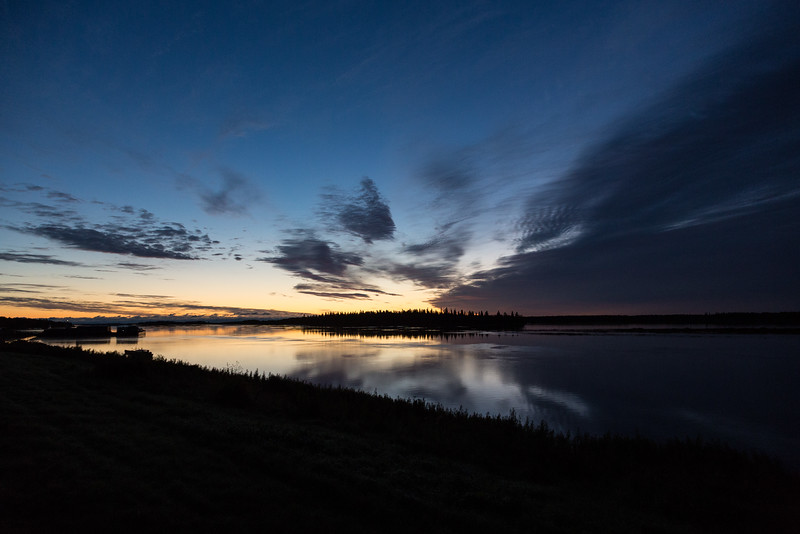 Sky across the Moose River well before sunrise. Mostly dark.