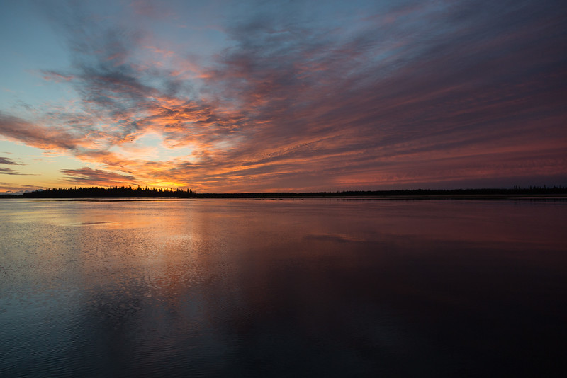 Looking across the Moose River from Moosonee shortly before sunrise. Purple fading in the clouds.