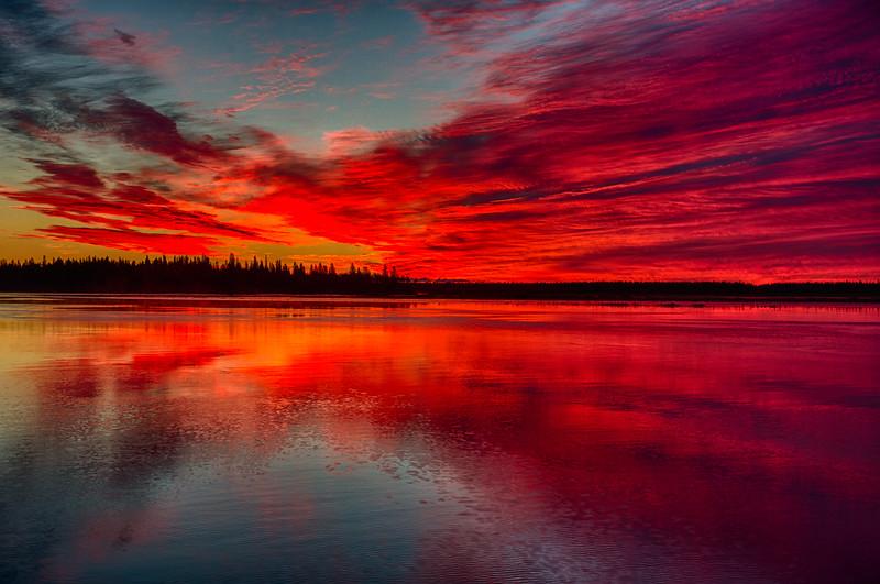 Sky around Butler Island before sunrise. Purple sky and water. HDR efx dark.