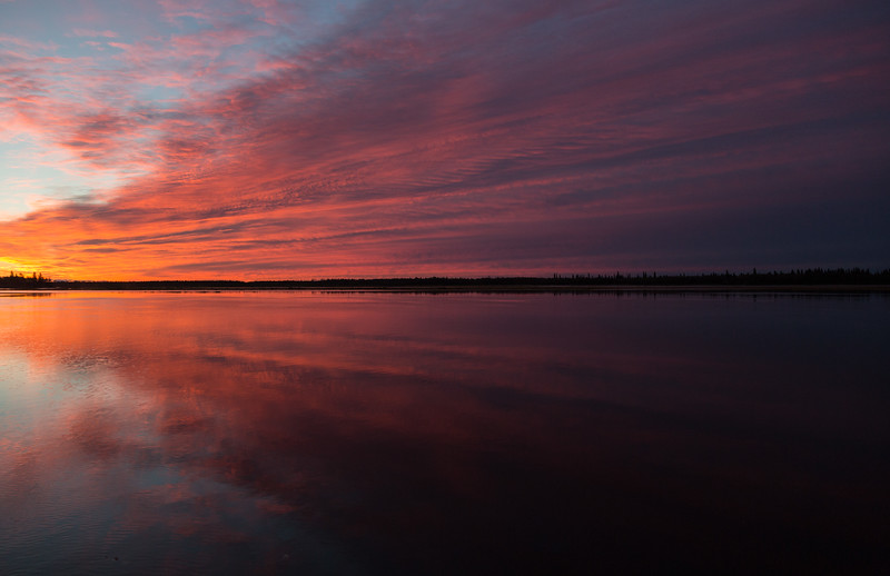 Purple sky and water across the river from Moosonee. South end of Butler Island at left.