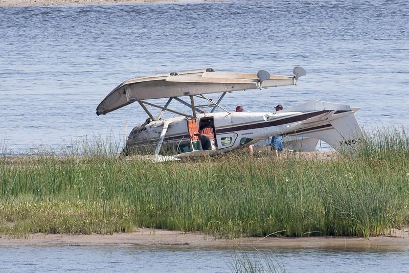 Cessna U206G C-GRVX flipped on sandbar in the Moose River across from Moosonee, Ontario 2009 August 11th