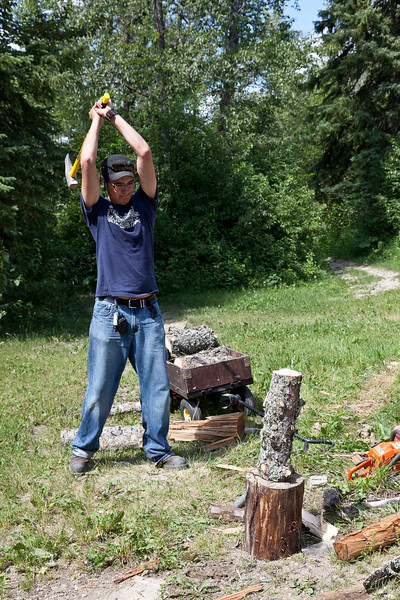 Jamie Sutherland chopping wood for campers.