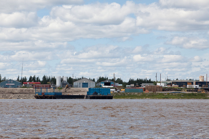 Barges docked at Moosonee. Note boxcars above shoreline ready for easy transfer of goods from rail to water.