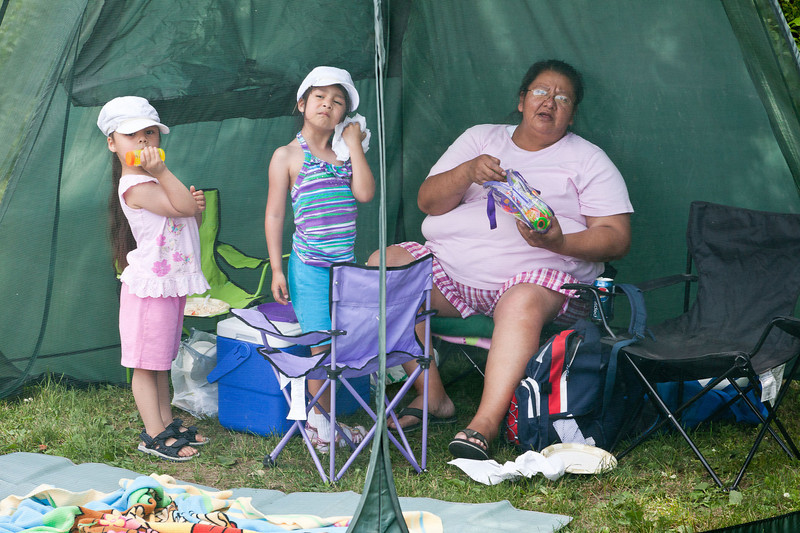 Mary Rose Kamalatisit with children in screen tent.