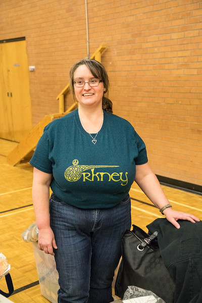 Christmas Flea Market in Moosonee 2016 December 17th. Val Hunter selling knitting stuff in an Orkney t-shirt.