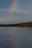 Partial rainbow down the Moose River with faint reflection.