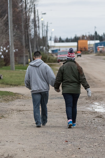 David Hunter and Mercedes walking on Revillon Road in Moosonee.