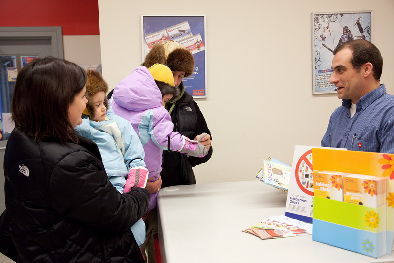 Moosonee children picking up their Dolly Parton books at post office.