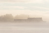 Barge at anchor on the Moose River at Moosonee on a foggy morning.