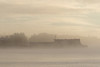 Barge anchored at Moosonee on the Moose River on a foggy morning.