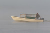 David MacDonald drives his taxi boat on a foggy morning.