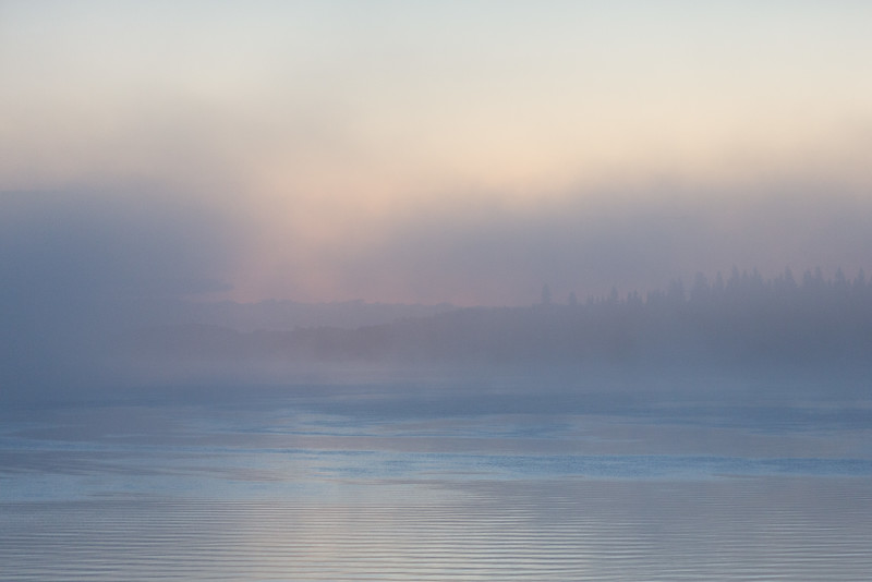 Fog over the Moose River thickens before sunrise at Moosonee.