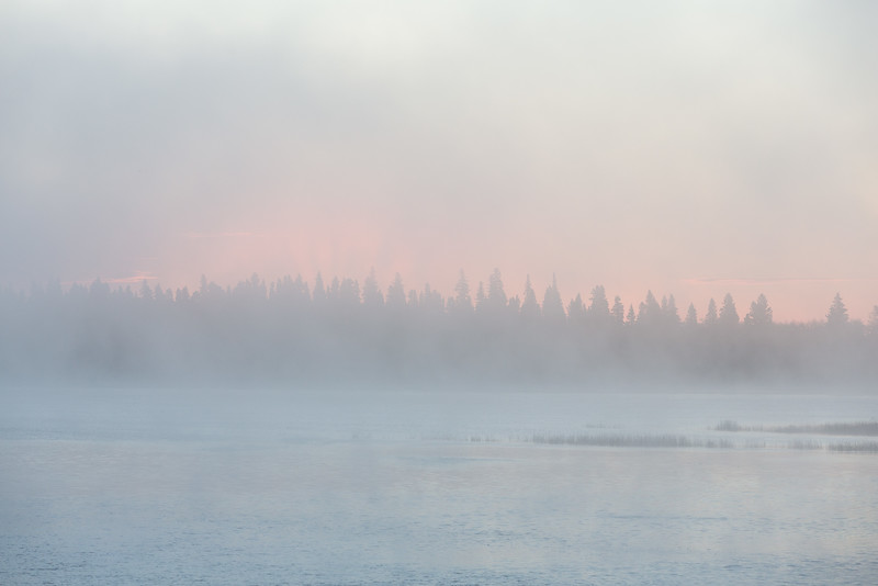 Hints of approaching sunrise on a foggy morning.