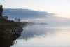 Moose River shoreline before sunrise as fog rolls in. Loking down river.