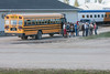 Tourists by Two Bay Tours bus at Moosonee train sttation 2006 July 23rd.