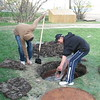 Brandon Iserhoff breaking up old clay drainage tile to fill up a septic tank at Keewaytinok Native Legal Services 2007 May 28th.