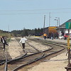 2007 May 28th people walking on tracks while they wait for train.