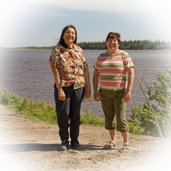 Rachel Chakasim and Pauline Sackaney along the river bank in Moosonee.