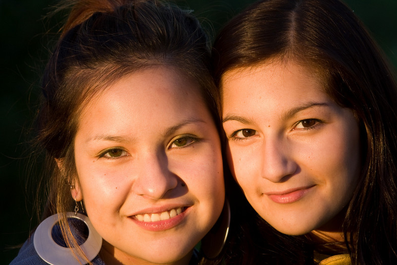 Two young women along the Moose River in Moosonee, Ontario just before sunset.