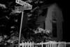 Moosonee, Ontario, street sign for corner of Butcher and Revillon, Revillon Freres in background, night shot