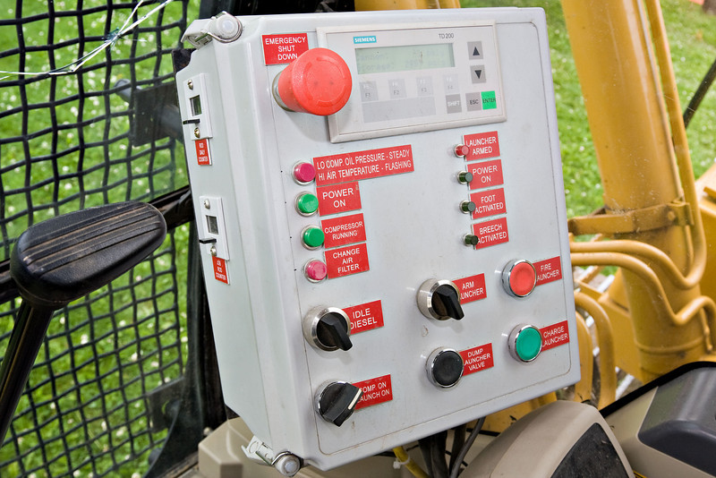 Control panel for nail driving inside excavator cab.