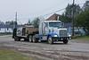 Truck and float trailer on Revillon Road North in Moosonee.