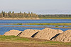 Piles of gravel on Moosonee shoreline ready for use in shoreline stabilization project.