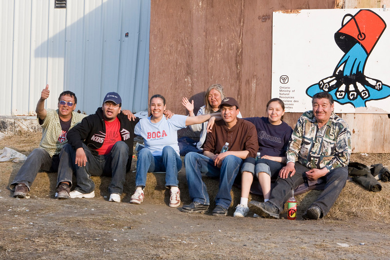 People enjoying a warm day behind the old water treatment plant in Moosonee