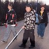 Boys returning home from playing ball hockey