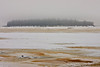Butler Island in the Moose River as seen from Moosonee, Ontario on a foggy day 2008 January 8th.
