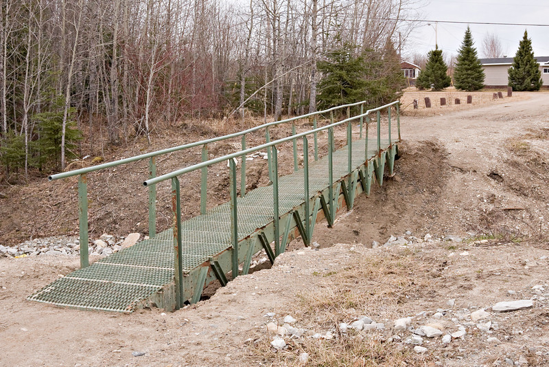 Bridge across ditch that cuts Tacan Road in Moosonee