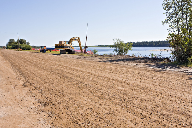 View of soil nailing operations along Revillon Road North in Moosonee near intersection with Fourth Street. Soil nailing is part of the river bank stabilization program.