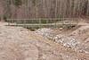 Bridge across ditch that cuts Tacan Road in Moosonee
