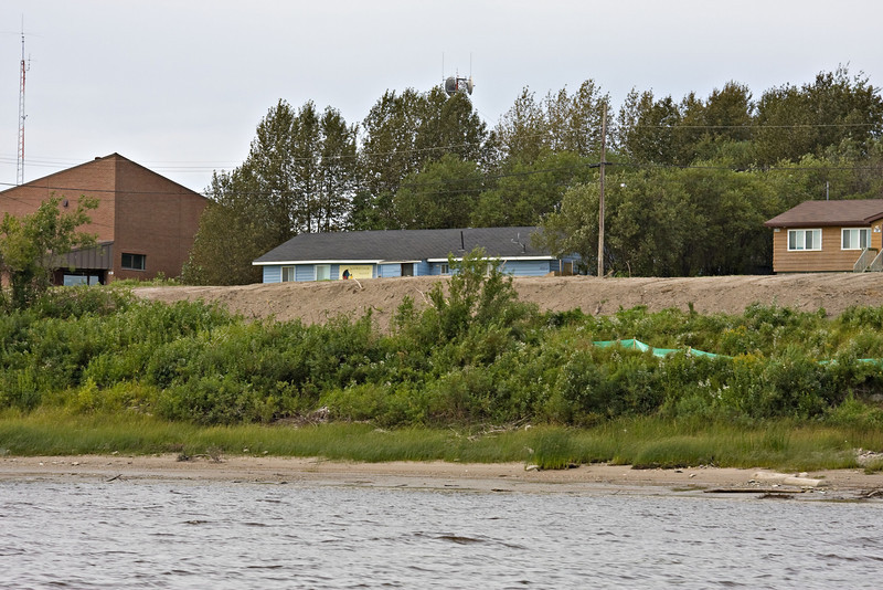 Moosonee river bank after shoreline stabilization program underway, soil nails have been cut off and fill added in this view just down stream of the Ontario Government building.