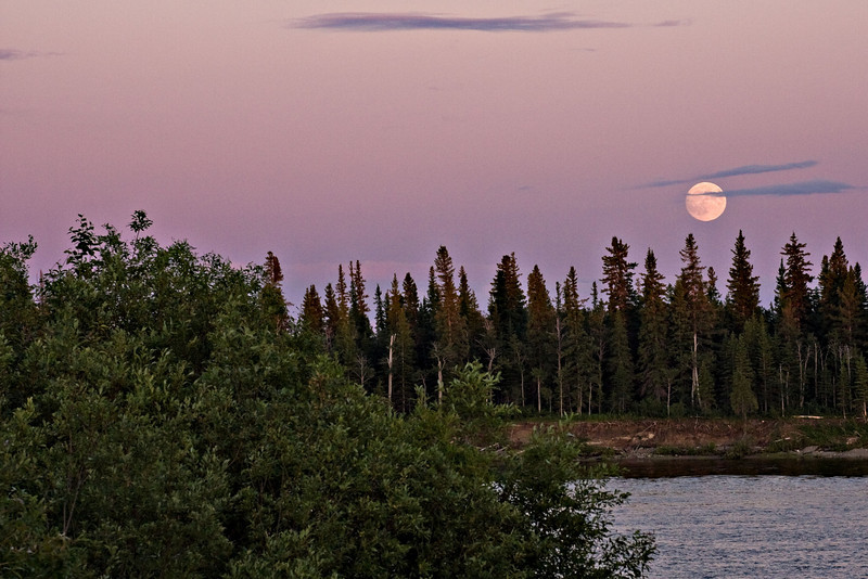 Fuel moon above the Moose River at sunset