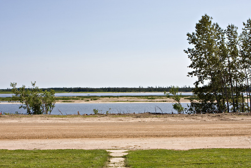 View across Revillon Road North in Moosonee showing shoreline clearing done as part of stabilization project.
