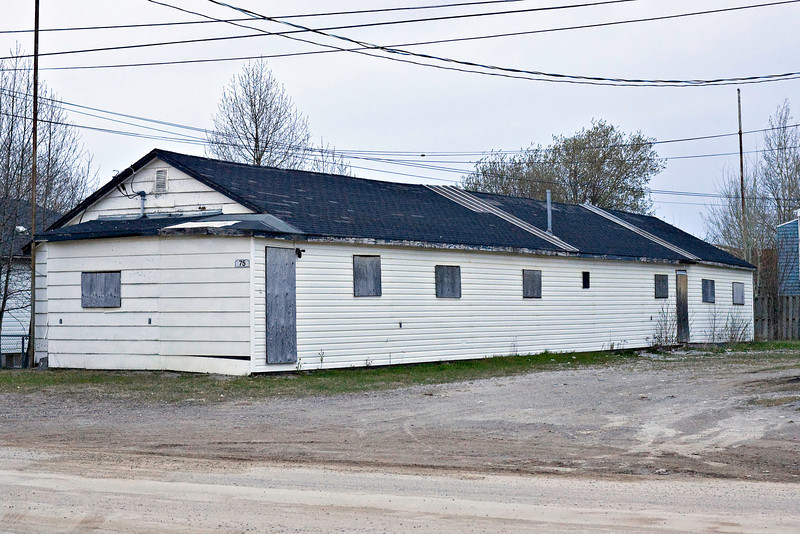 This building on Ferguson Road North is now unused but has been a bunkhouse and was once the Moosonee Meat Market. Note the poles at opposite corners that were formerly antenna supports.
