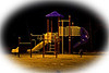 Playground equipment near Bert Trapper at night