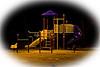 Playground equipment near Bert Trapper at night