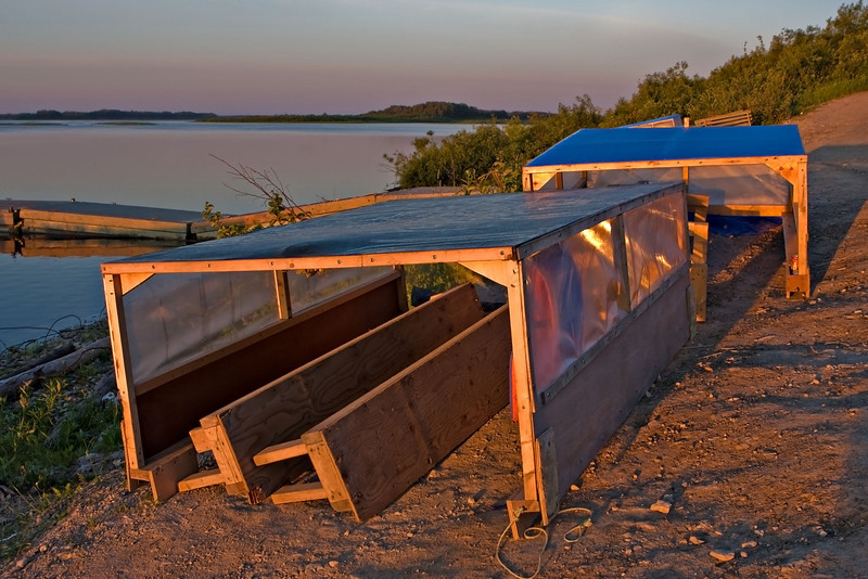 Boat covers on shore near public docks in Moosonee. These are used on taxi boats and taken off during good weather.