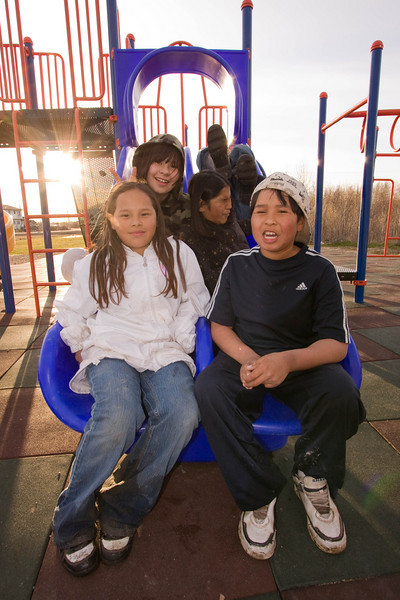 Group of children on double slide