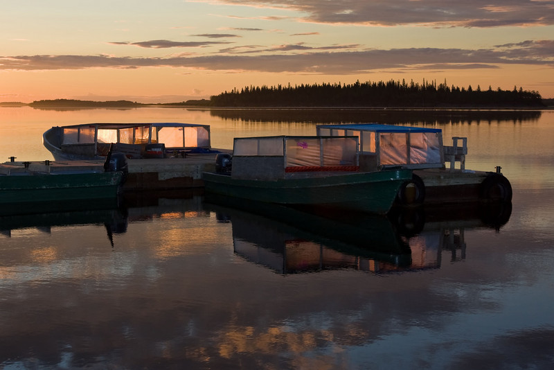 Taxi boats at public docks in Moosonee just after dawn